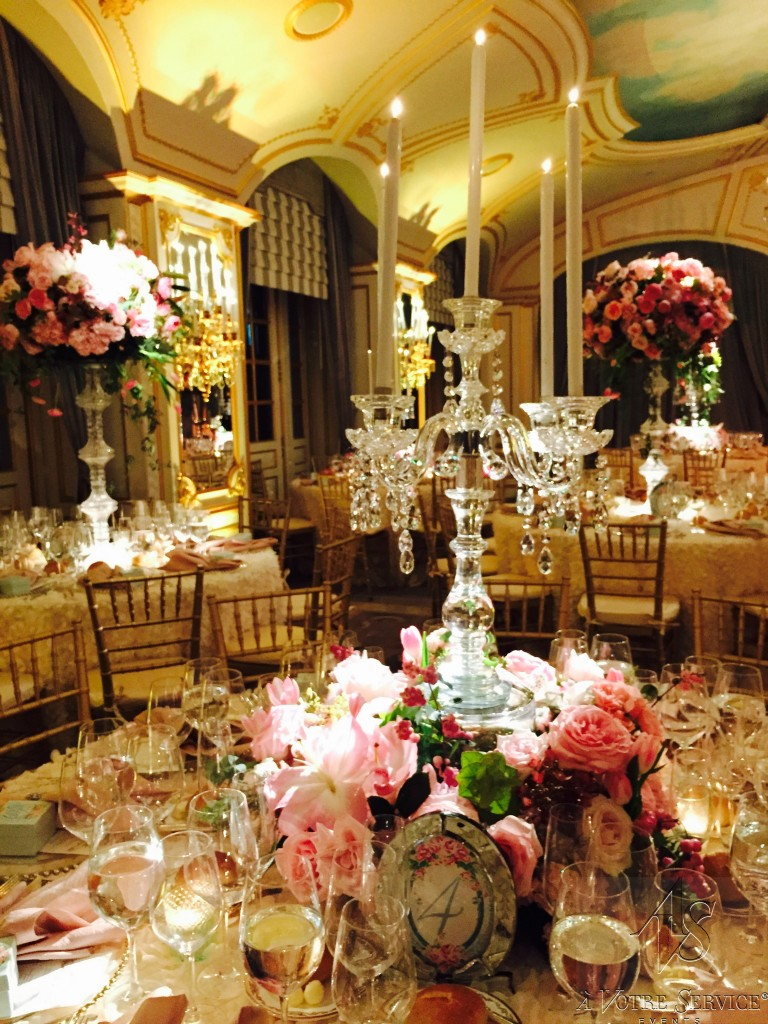 pink floral centerpiece and crystal candelabra